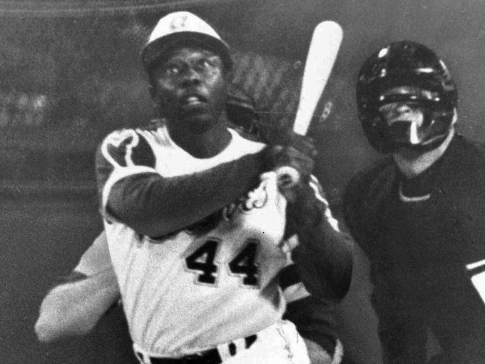 Just shy of 27 years after Jackie  Robinson broke the color barrier, another black man, Aaron, broke Ruth's career home run record.  Aaron did so for the Atlanta Braves against the Los Angeles Dodgers on April 8th, 1974.  Image source: USA Today