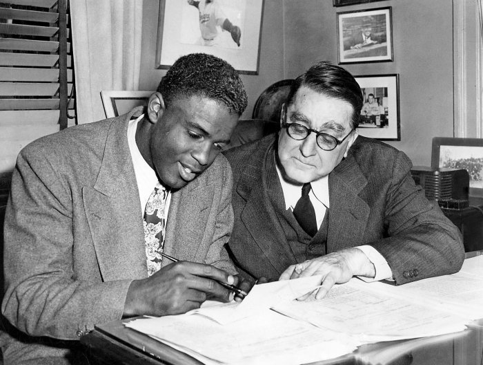 Baseball, Business, Breaking Barriers and Civil Rights: Robinson with Rickey as he signs his first Major League contract with the Brooklyn Dodgers, April 10th, 1947.  Image source: dailyoffice.org