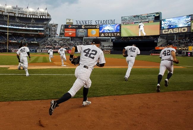 As an April 15th tradition, teams across Major League Baseball have taken to wearing Jackie  Robinson's 42 on their backs to celebrate Robinson's breaking of the color barrier and the diversity and opportunity in baseball.  Pictured here: the New York Yankees taking the field at Yankee Stadium wearing 42 on April 15th, 2013.  Image source: thewhig.com