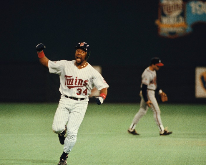 """We will see you tomorrow night!""  Kirby  Puckett circles the bases after hitting a walk-off home run against the Atlanta Braves in Game 6 of the 1991 World Series.  Mandatory Image Credit: The National Past Time Museum"