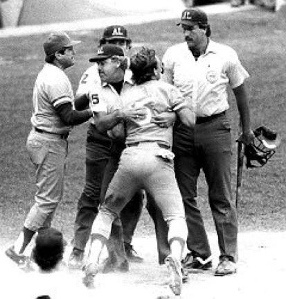 George Brett shouting down Tim McClelland and being restrained on July 24th, 1983 after McClelland called him out for having an excessive amount of pine tar on his bat. American League President Lee MacPhail would eventually overturn the call causing the Yankees and the Royals to have to finish the game at a later date. The Royals won, 5-4. Mandatory Image Credit: New York Daily News